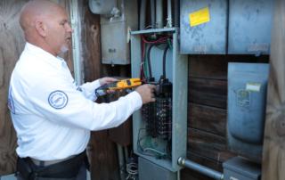 certified-electrician-fixing-circuit-breaker