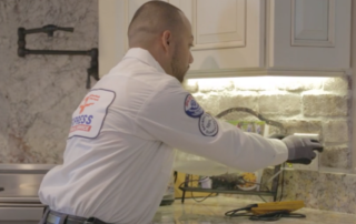express electrical specialist repairing kitchen outlet