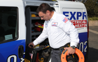 express electrical technician grabbing his tools from van