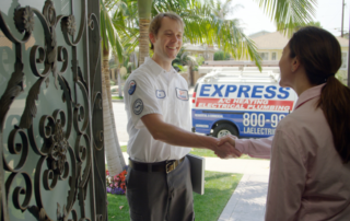 express electrician shaking hands with homeowner