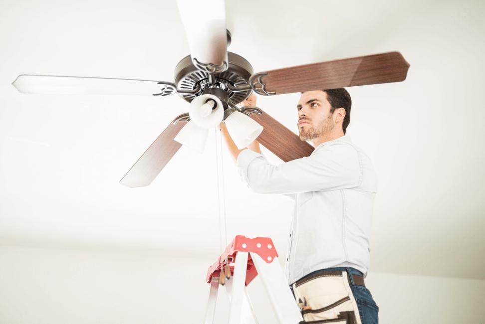 technician installing a ceiling fan