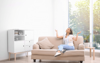 happy-lady-on-couch-enjoying-energy-efficient-house
