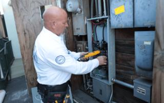 electrician-at-converter-box