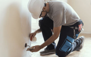 electrician-fixing-outlet