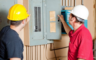 Repairmen-Reading-Electrical-Circuit Breaker Panel-