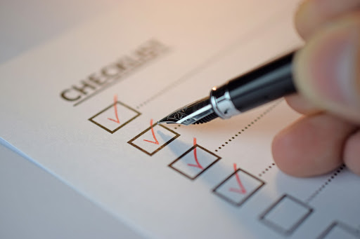 checklist-red-checks-ink-pen