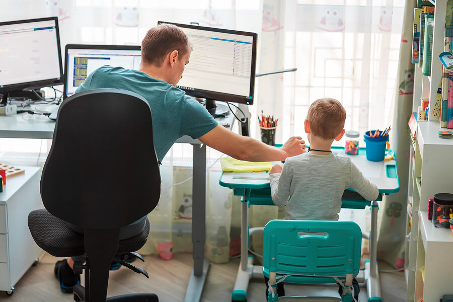 Father-With-Kid-Working-From-Home